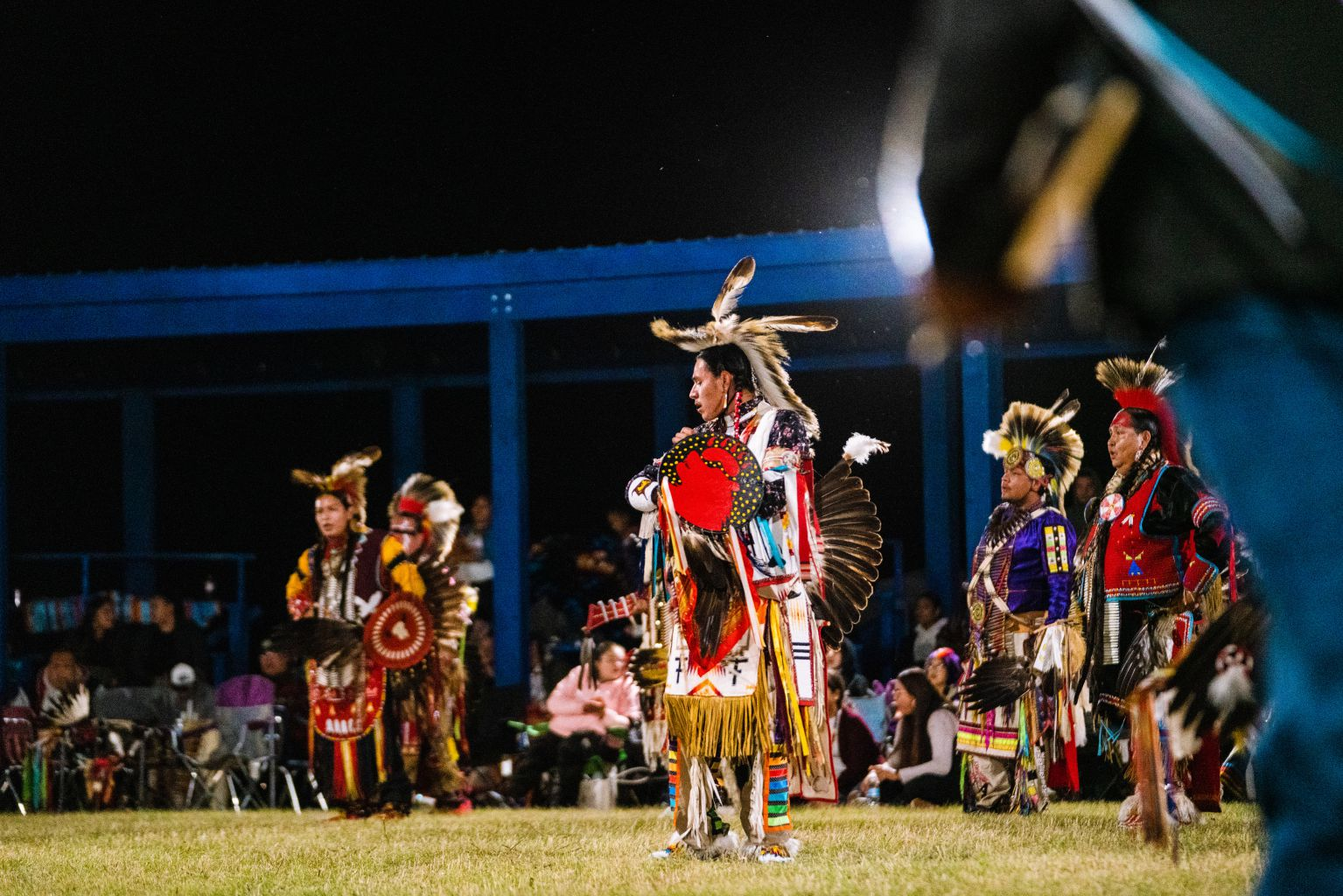 Native american pow wow dancers at night